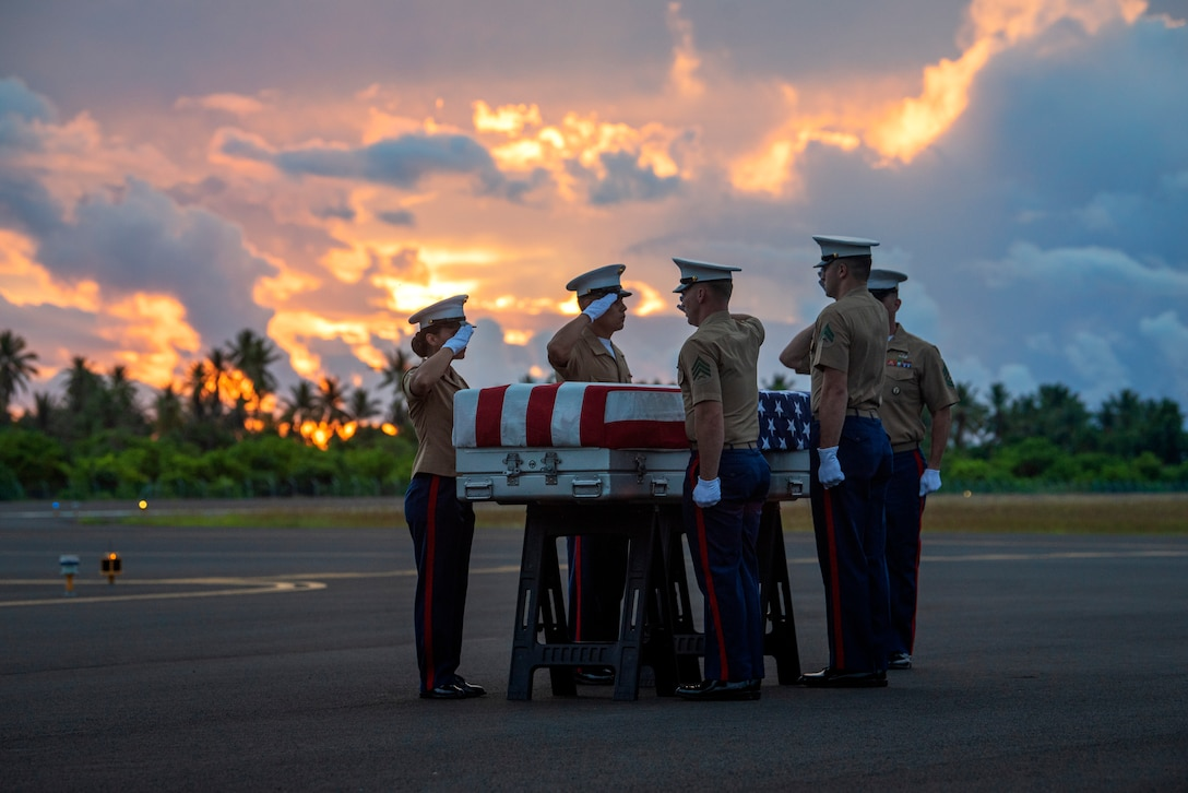 U.S. Marines from Marine Corps Forces, Pacific, salute a transfer case during a repatriation ceremony for the possible remains of unidentified service members lost in the Battle of Tarawa during WWII, Republic of Kiribati, July 18, 2019. The remains were recently recovered from sites in the Tarawa Atoll by History Flight, Inc., a DPAA partner organization, and will be accessioned into DPAA's laboratory facility in Hawaii to begin the identification process in support of DPAA's mission to provide the fullest possible accounting for our missing personnel to their families and the nation.