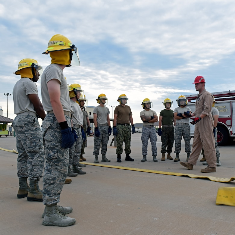 U.S. Air Force Staff Sgt. Jonathan Kidd, 312th Training Squadron fire instructor, teaches students from the Army, Navy, Air Force, Marines, and Coast Guard in support of the joint mission at the Louis F. Garland Department of Defense Fire Academy at Goodfellow Air Force Base, Texas, July 11, 2019. The students go through a 68-day course learning fire protection dealing with the unique environments found all over the world on military installations. (U.S. Air Force photo by Airman 1st Class Robyn Hunsinger/Released)