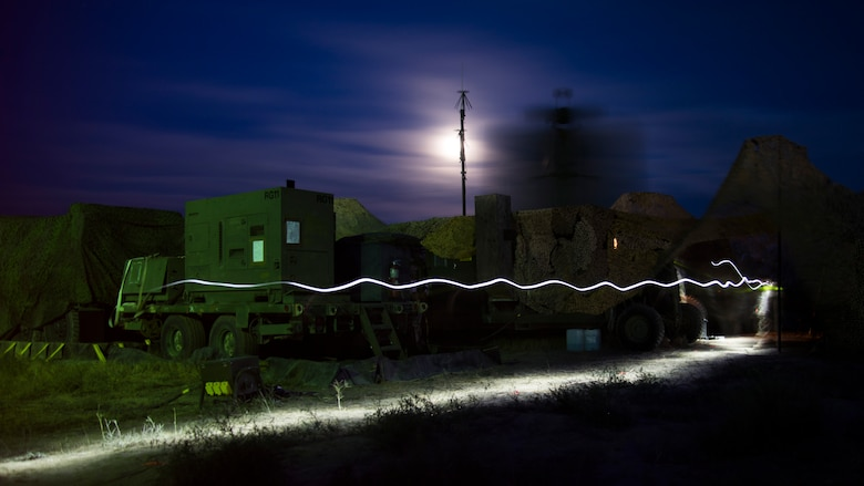A U.S. Air Force Airman from the 726th Air Control Squadron walks by a spinning TPS-75 radar sytem with a flashlight in hand during Hardrock Exercise 19-2, July 15, 2019, at Mountain Home Air Base, Idaho. The exercise was in a simulated deployed location where the base was built from the ground up and took control of the airspace. (U.S. Air Force photo by Airman 1st Class Andrew Kobialka)