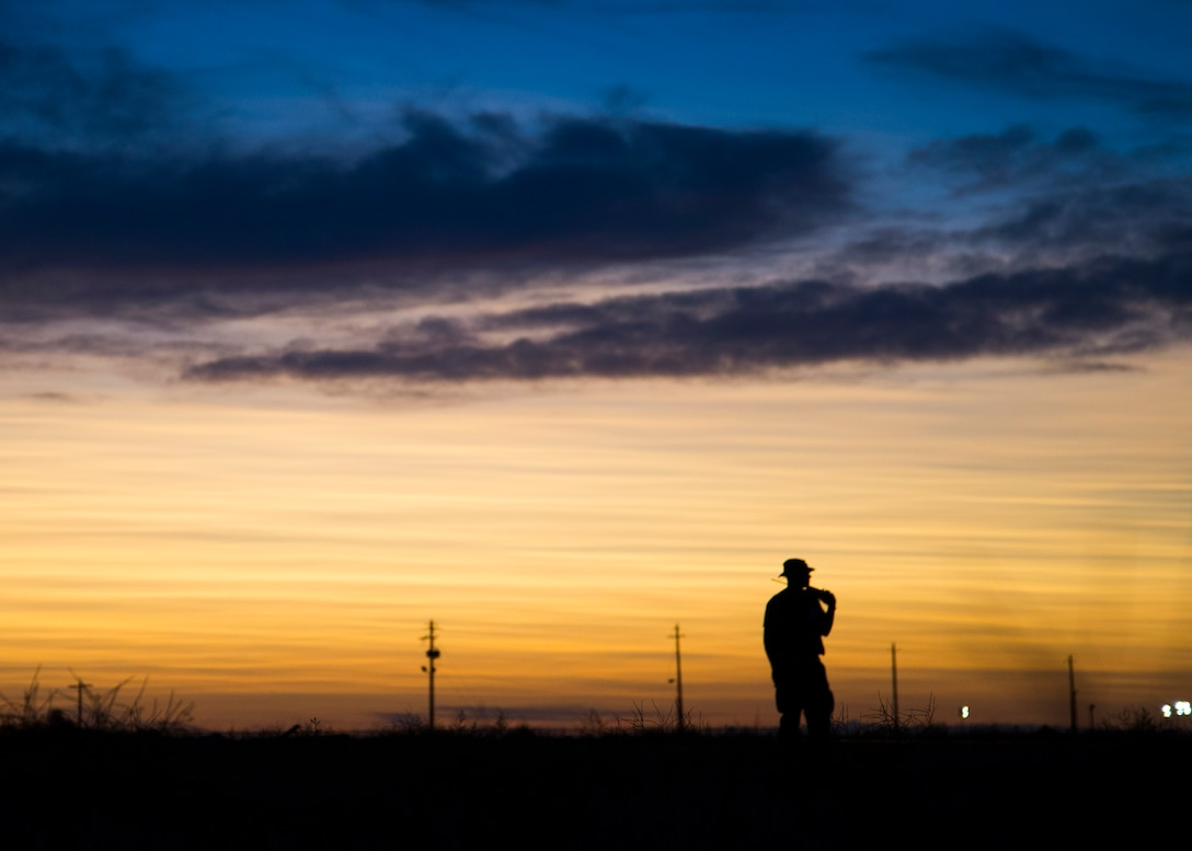 A U.S. Air Force Airman from the 726th Air Control Squadron scans the perimeter of the Mobile Operating Air Base (MOAB) during Hardrock Exercise 19-2, July 16, 2019, at Mountain Home Air Base, Idaho. The exercise was in a simulated deployed location where the base was built from the ground up and took control of the airspace. (U.S. Air Force photo by Airman 1st Class Andrew Kobialka)