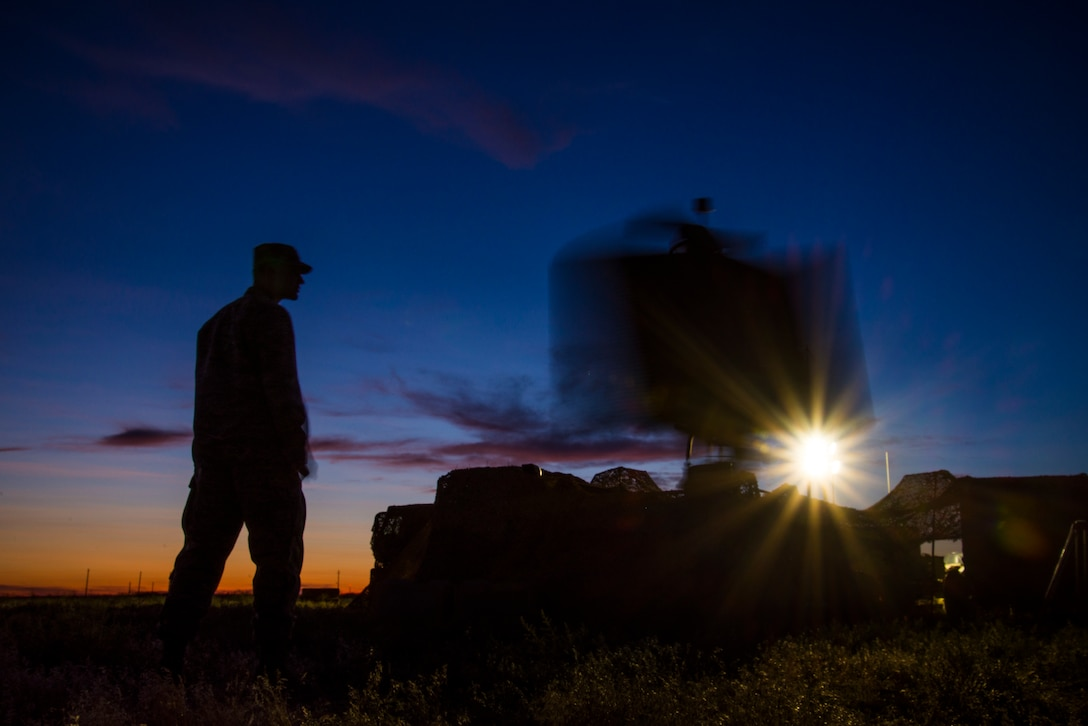 A U.S. Air Force Airman stands next to a TPS-75 radar system while it scans the skies during Hardrock Exercise 19-2, July 16, 2019, at Mountain Home Air Base, Idaho. The exercise was in a simulated deployed location where the base was built from the ground up and took control of the airspace. (U.S. Air Force photo by Airman 1st Class Andrew Kobialka)