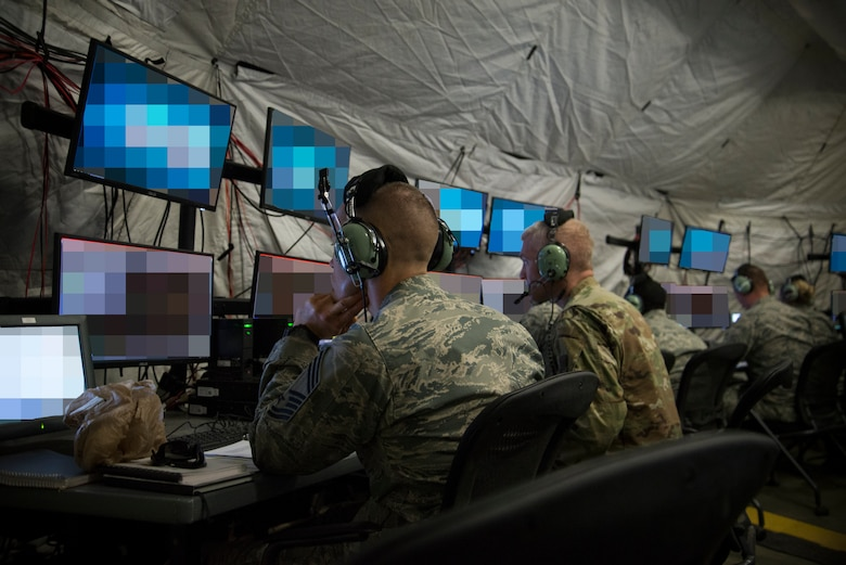 U.S. Air Force Airmen from the 726th Air Control Squadron control the airspace from inside a tactical operations center during Hardrock Exercise 19-2, July 17, 2019, at Mountain Home Air Base, Idaho. The exercise was in a simulated deployed location where the base was built from the ground up and took control of the airspace. The monitors were blurred as a security precaution. (U.S. Air Force photo by Airman 1st Class Andrew Kobialka)