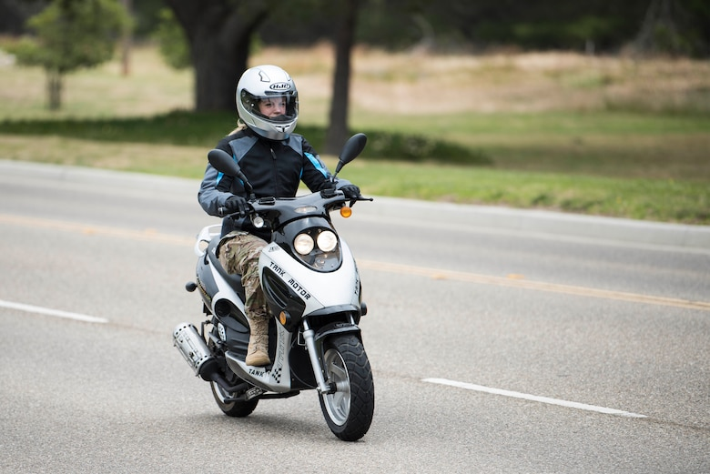 Staff Sgt. Erika Darcy, 614th Air Operations Center intel analyst and motorcycle safety representative, rides down California Avenue May 29, 2019, at Vandenberg Air Force Base, Calif. Before riding at Vandenberg, Airmen are required to go through a basic rider's course offered by the motorcycle safety program's local training agency partners, which provide Airmen with the necessary lifesaving skills for riding on the open road. (U.S. Air Force photo by Airman 1st Class Hanah Abercrombie)