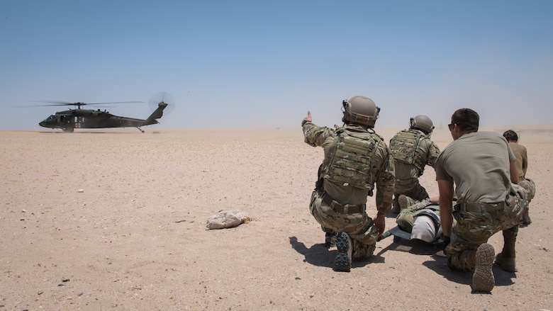 Airmen from the 386th Expeditionary Medical Group based at Ali Al Salem Air Base, Kuwait, and Tactical Air Control Party Airmen with the 82nd Expeditionary Air Support Operations Squadron, prepare to transport a patient onto a UH-60 Blackhawk helicopter during medical evacuation training at Camp Buehring, Kuwait, July 12, 2019. Medics and TACP's trained together to hone their skills and become more efficient at treating injuries and coordinating medevac efforts for casualties. (U.S. Air Force photo by Tech. Sgt. Daniel Martinez)