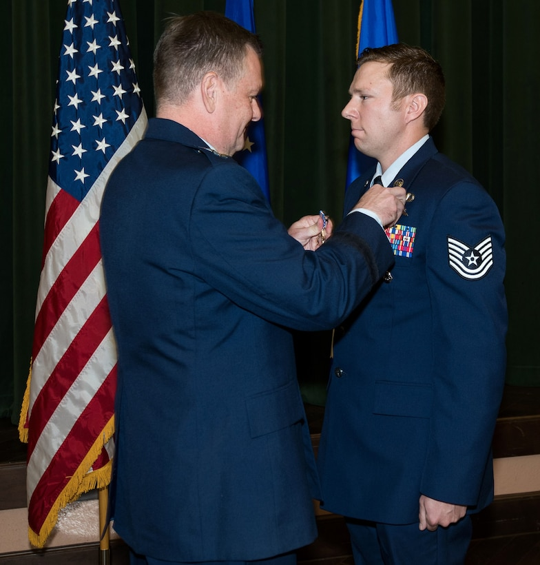 Lt. Gen. Bradd Webb, incoming commander for Air Education and Training Command, presents the Silver Star to Tech. Sgt. Michael Perolio from the Special Warfare Training Wing during a ceremony at Joint Base San Antonio-Lackland's Gateway Club July 18. Perolio was presented the Silver Star in connection to military operations against an armed enemy in Afghanistan Jan. 11, 2018, during Operation Freedom's Sentinel.