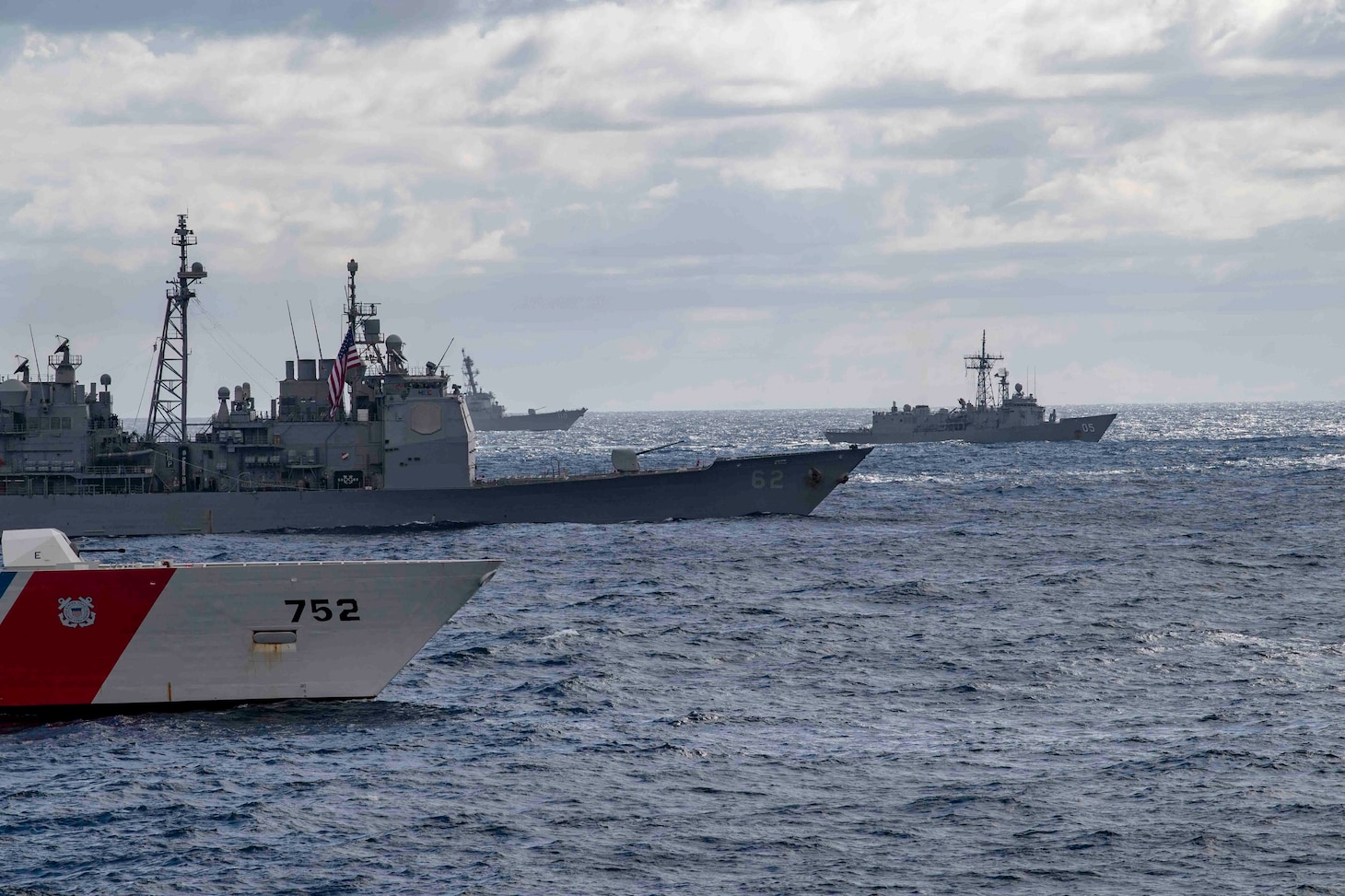 TASMAN SEA (July 11, 2019) The USCGC Stratton (WMSL 752), far left, USS Chancellorsville (CG 62), left, HMAS Melbourne (FFG 05), center, and USS William P. Lawrence (DDG 110) transit with the Arleigh Burke-class guided-missile destroyer USS McCampbell (DDG 85) during a photo exercise (PHOTOEX) as part of the exercise Talisman Sabre 2019. McCampbell, part of the Wasp Expeditionary Strike Group, with embarked 31st Marine Expeditionary Unit, is currently participating in Talisman Sabre 2019 off the coast of Northern Australia. A bilateral, biennial event, Talisman Sabre is designed to improve U.S. and Australian combat training, readiness and interoperability through realistic, relevant training necessary to maintain regional security, peace and stability.