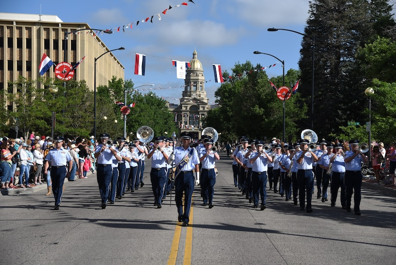 Members of the U.S. Air Force Academy Band play music as they march down the streets of Cheyenne, Wyo., during the 123rd Cheyenne Frontier Days opening Grand Parade, July 20, 2019. Airmen play many roles in making CFD, the biggest event in Cheyenne, a success. The two communities came together to celebrate during the CFD rodeo and festival. (U.S. Air Force photo by Glenn S. Robertson)