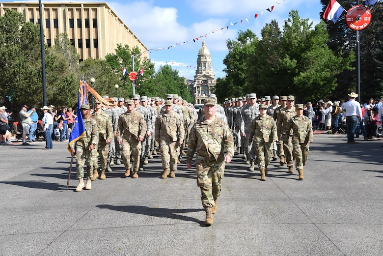 Col. Brian Young, 90th Missile Wing Vice Commander, leads a flight of approximately 150 Airmen during the 123rd Cheyenne Frontier Days opening Grand Parade in Cheyenne, Wyo., July 20, 2019. CFD represents the continuous partnership between F.E. Warren Air Force Base and the Cheyenne community. The F.E. Warren Air Force Base and Cheyenne communities came together to celebrate the CFD rodeo and festival, which runs from July 19-28. (U.S. Air Force photo by Glenn S. Robertson)