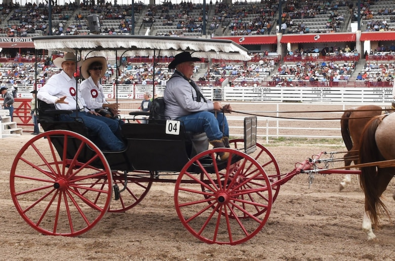 General Timothy Ray and his wife Rhonda ride onto the Cheyenne Frontier Days grounds as part of the Grand Entrance in Cheyenne, Wyo., July 20, 2019. The Grand Entrance marks the official start to rodeo at CFD. The F.E. Warren Air Force Base and Cheyenne communities came together to celebrate the CFD rodeo and festival, which runs from July 19-28. (U.S. Air Force photo by Senior Airman Breanna Carter.)