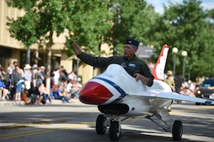 Col. Paul Lyman, Assistant Adjutant General, Wyoming National Guard, waves at the crowd while driving a miniature motorized vehicle during the 123rd Cheyenne Frontier Days opening Grand Parade in Cheyenne, Wyo., July 20, 2019. Service members from multiple branches took part in the parade. This year marks the 152nd anniversary of F.E. Warren Air Force Base and the city of Cheyenne. The F.E. Warren Air Force Base and Cheyenne communities came together to celebrate the CFD rodeo and festival, which runs from July 19-28. (U.S. Air Force photo by Staff Sgt. Ashley N. Sokolov)
