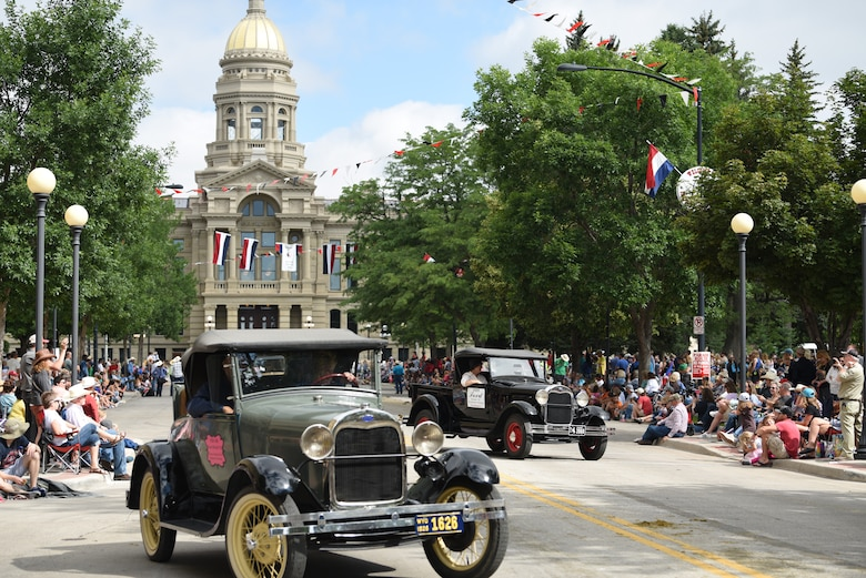 Parade participants drive historic cars during the Grand Parade in Cheyenne, Wyo., July 20, 2019. The Cheyenne community and F.E. Warren Air Force Base have been working together for 123 years to keep the Daddy of 'em all running smoothly. (U.S. Air Force photo by Staff Sgt. Ashley N. Sokolov)
