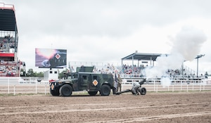 Airmen from the 90th Munitions Squadron fire a cannon at the Grand Entrance to the Cheyenne Frontier Days grounds July 20, 2019 in Cheyenne, Wyo. The Grand Entrance marks the official beginning of the rodeo at CFD. The F.E. Warren Air Force Base and Cheyenne communities came together to celebrate the CFD rodeo and festival, which runs from July 19-28. (U.S. Air Force photo by Senior Airman Abbigayle Williams)