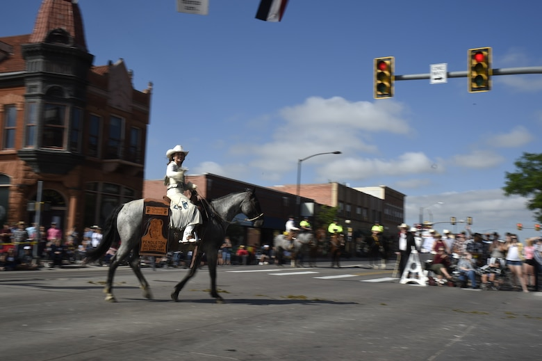 Rodeo Queen Sydney Jones of Pendleton, Ore., turns her horse from Lincolnway to Carey Ave. during the Cheyenne Frontier Days Grand Parade July 20, 2019, in Cheyenne, Wyo. Rodeo Queens from all over the United States joined in the parade. The F.E. Warren Air Force Base and Cheyenne communities came together to celebrate the CFD rodeo and festival, which runs from July 19-28. (U.S. Air Force photo by Tech Sgt. Tyler Placie)