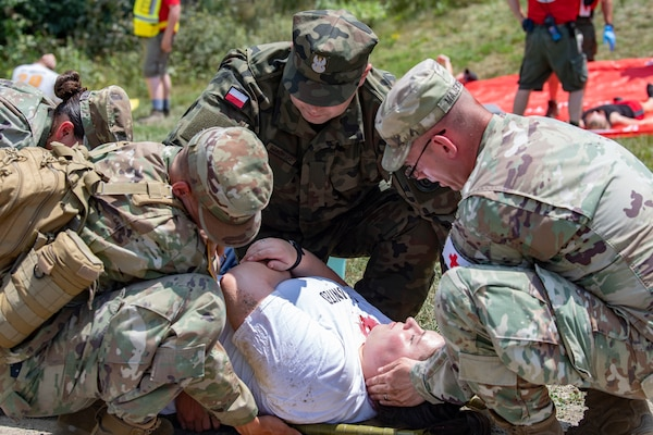 Members of the Connecticut Army National Guard, assisted by a Polish Territorial Defense Forces member, treats a mock patient July 20, 2019, at the Summit Bechtel Reserve in Glen Jean, W.Va. Various National Guard and active duty military units, local emergency services, World Scout Jamboree Staff, and Polish Territorial Defense Forces participated in the exercise in preparation for the 24th World Scout Jamboree. (U.S. Air National Guard Photo by Senior Airman Caleb Vance)