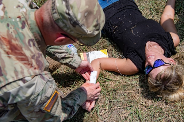 A Soldier from the Connecticut Army National Guard prepares to treat a mock patient while participating in a Medical Readiness Exercise on July 20, 2019, at the Summit Bechtel Reserve in Glen Jean, W.Va. Various National Guard and active duty military units, local emergency services, World Scout Jamboree Staff, and Polish Territorial Defense Forces participated in the exercise in preparation for the 24th World Scout Jamboree. (U.S. Air National Guard Photo by Senior Airman Caleb Vance)