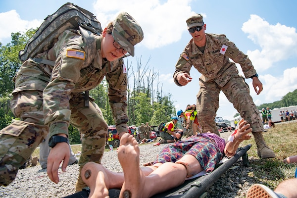 Connecticut Army National Guard Soldiers prepare to transport a mock victim while participating in a Medical Readiness Exercise, July 20, 2019, at the Summit Bechtel Reserve, in Glen Jean, W.Va. Various National Guard and active duty military units, local emergency services, World Scout Jamboree Staff, and Polish Territorial Defense Forces participated in the exercise in preparation for the 24th World Scout Jamboree. (U.S. Air National Guard Photo by Senior Airman Caleb Vance)