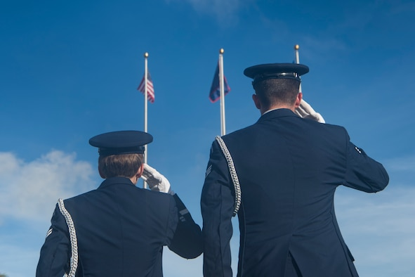 Airmen from the Blue Knights honor guard team salute during the playing of the national anthem during the RAIDR 21 memorial ceremony July 21, 2019 at Andersen Air Force Base, Guam.