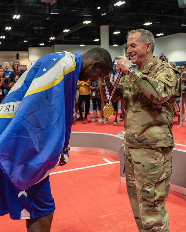 Air Force Chief of Staff Gen. David L. Goldfein  Staff Sgt. Kevin J. Greene, Team Air Force athlete, during the wheelchair basketball finals at the 2019 Department of Defense Warrior Games at Tampa, Fla, June 28, 2019. The Warrior Games is an annual sporting competition that brings together wounded and injured military members from each branch. (U.S. Air Force photo by Tech Sgt. Lionel Castellano)