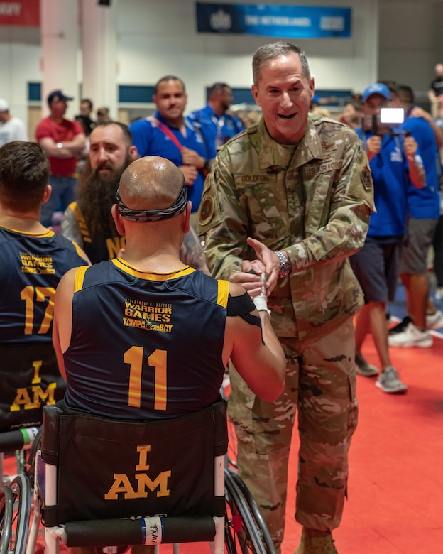 Air Force Chief of Staff Gen. David L. Goldfein congratulates Hospital Corpsman 1st Class Carlos Valerio, a Team Navy athlete, for a well-played game after Team Air Force defeated Team Navy 66-60 in wheelchair basketball at the 2019 Department of Defense Warrior Games at Tampa, Fla, June 28, 2019. The Warrior Games showcase the resilient spirit of today's service members across all branches of the military. (U.S. Air Force photo by Tech Sgt. Lionel Castellano)