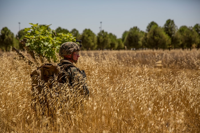 A U.S. Marine with Special Purpose Marine Air-Ground Task Force-Crisis Response-Africa 19.2, Marine Forces Europe and Africa, posts security during a tactical recovery of aircraft and personnel mission rehearsal on Moron Air Base, Spain, July 2, 2019. The rehearsal was conducted to maintain high-response time and proficiency in night operations as a crisis-response force. SPMAGTF-CR-AF is deployed to conduct crisis-response and theater-security operations in Africa and promote regional stability by conducting military-to-military training exercises throughout Europe and Africa. (U.S. Marine Corps photo by Cpl. Margaret Gale)