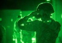 A U.S. Marine with Special Purpose Marine Air-Ground Task Force-Crisis Response-Africa 19.2, Marine Forces Europe and Africa, prepares his night-vision goggle for a tactical recovery of aircraft and personnel mission rehearsal on Moron Air Base, Spain, July 4 , 2019. The rehearsal was conducted to maintain high-response time and proficiency in night operations as a crisis-response force. SPMAGTF-CR-AF is deployed to conduct crisis-response and theater-security operations in Africa and promote regional stability by conducting military-to-military training exercises throughout Europe and Africa. (U.S. Marine Corps photo by Cpl. Margaret Gale)