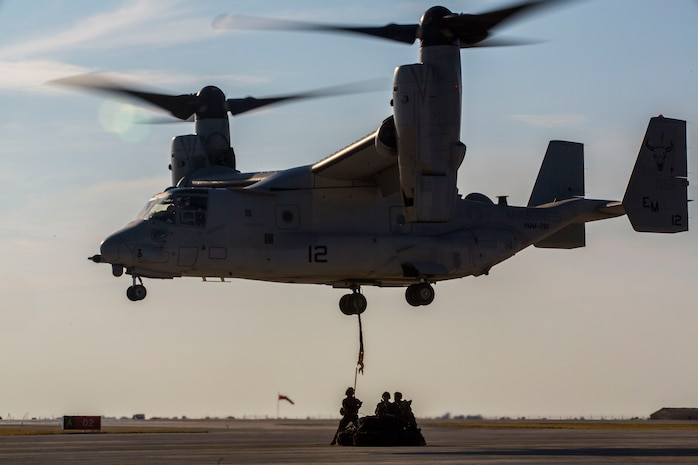A U.S. Marine Corps MV-22B Osprey with Special Purpose Marine Air-Ground Task Force-Crisis Response-Africa 19.2, Marine Forces Europe and Africa, conducts an external lift during helicopter support team training on Moron Air Base, Spain, July 9, 2019. The exercise was conducted to increase interoperability between the aviation combat element and logistics combat element. SPMAGTF-CR-AF is deployed to conduct crisis-response and theater-security operations in Africa and promote regional stability by conducting military-to-military training exercises throughout Europe and Africa. (U.S. Marine Corps photo by Cpl. Margaret Gale)