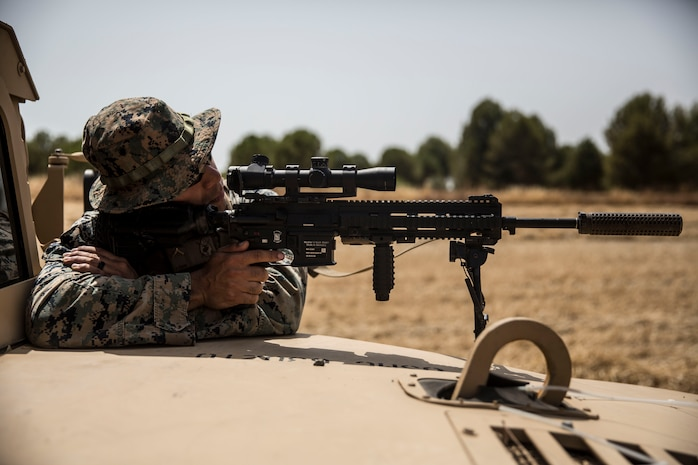 A U.S. Marine with Special Purpose Marine Air-Ground Task Force-Crisis Response-Africa 19.2, Marine Forces Europe and Africa, provides security during an entry control point training rehearsal on Moron Air Base, Spain, July 11, 2019. Marines practiced vehicle control and entry control point procedures used to identify and search vehicles and personnel. SPMAGTF-CR-AF 19.2 is deployed to conduct crisis-response and theater-security operations in Africa and promote regional stability by conducting military-to-military training exercises throughout Europe and Africa. (U.S. Marine Corps photo by Cpl. Margaret Gale)