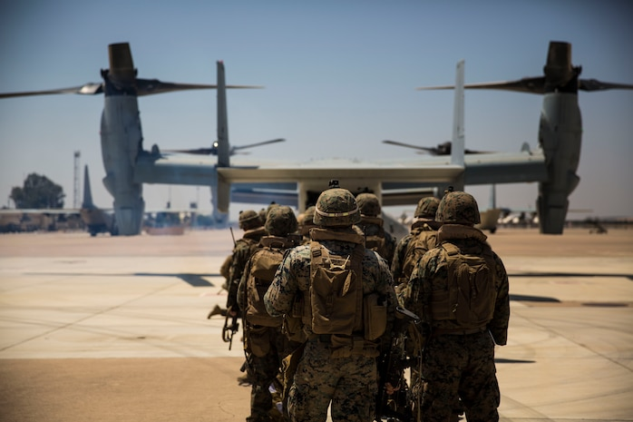 U.S. Marines with Special Purpose Marine Air-Ground Task Force-Crisis Response-Africa 19.2, Marine Forces Europe and Africa, prepare to board a U.S. Marine Corps MV-22B Osprey on Moron Air Base, Spain, July 15, 2019, during a tactical recovery of aircraft and personnel training exercise. TRAP is a core function of a crisis-response force and SPMAGTF-CR-AF 19.2 consistently trains to increase TRAP proficiency by rehearsing realistic scenarios which force the Marines and Sailors to make quick decisions under stress. SPMAGTF-CR-AF is deployed to conduct crisis-response and theater-security operations in Africa and promote regional stability by conducting military-to-military training exercises throughout Europe and Africa. (U.S. Marine Corps photo by Cpl. Margaret Gale)