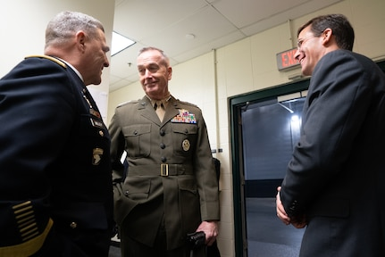 Marine Corps Gen. Joseph F. Dunford, Jr., chairman of the Joint Chiefs of Staff, speaks with Army Gen. Mark A. Miley, Chief of Staff of the Army, and Dr. Mark T Esper, Secretary of the Army, before the 2018 Army Navy Game in Philadelphia, Pa., Dec. 8, 2018.  The U.S. Military Academy cadets from West Point broke a 14-year Navy win streak after defeating the U.S. Naval Academy Midshipmen 21-17.