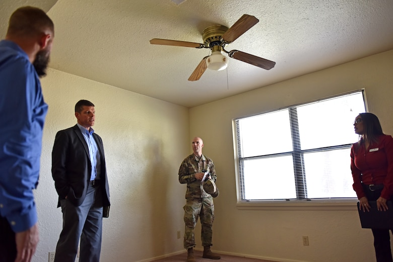 The Honorable John W. Henderson, Assistant Secretary of the Air Force for Installations, Environment and Energy, receives a tour of on base of permanent party housing during his visit to Goodfellow Air Force Base, Texas, July 11, 2019. One subject discussed during the visit was the infrastructure and housing for permanent party and students. (U.S. Air Force photo by Senior Airman Seraiah Wolf/Released)