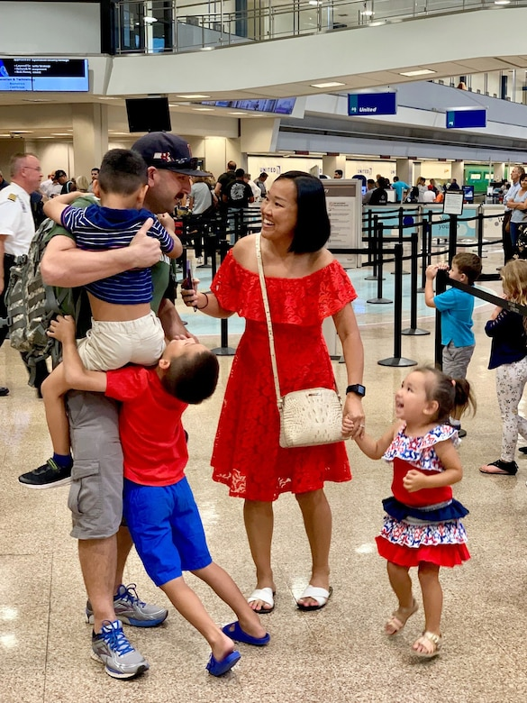 Tech. Sgt. Christopher Korpita, 419th Maintenance Squadron, is met by his wife, Khaliun, and three children after he returned home from a three-month deployment to the United Arab Emirates on July 19.