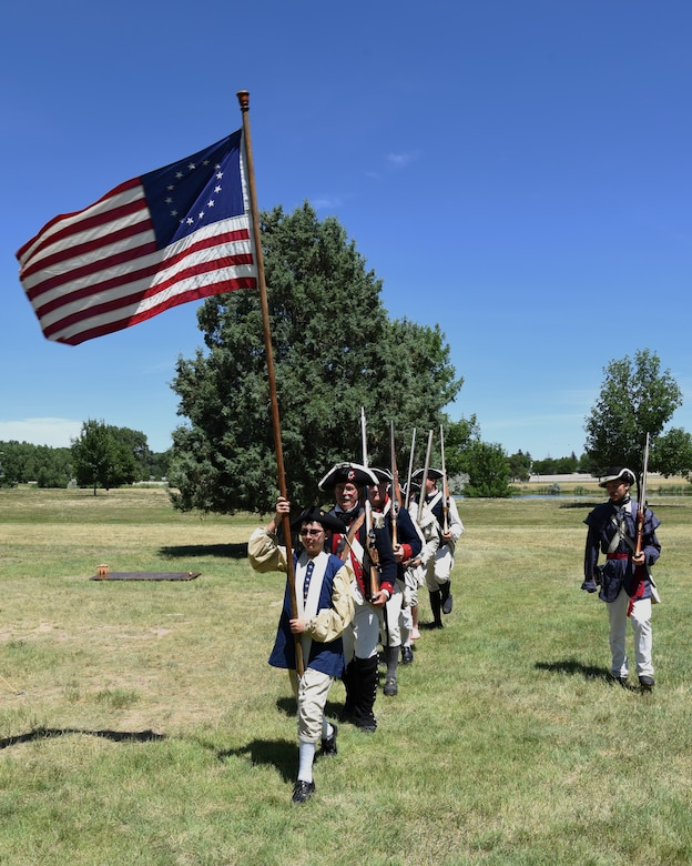 Revolutionary War reenactors march into position for a demonstration at F.E. Warren Air Force Base, Wyo., July 20, 2019 as part of the annual Fort D.A. Russell Days. D. A. Russell Days allows the base to showcase the current mission while also giving visitors a realistic glimpse of the base's history. This year marks the 25th iteration of the event. (U.S. Air Force photo by Glenn S. Robertson)