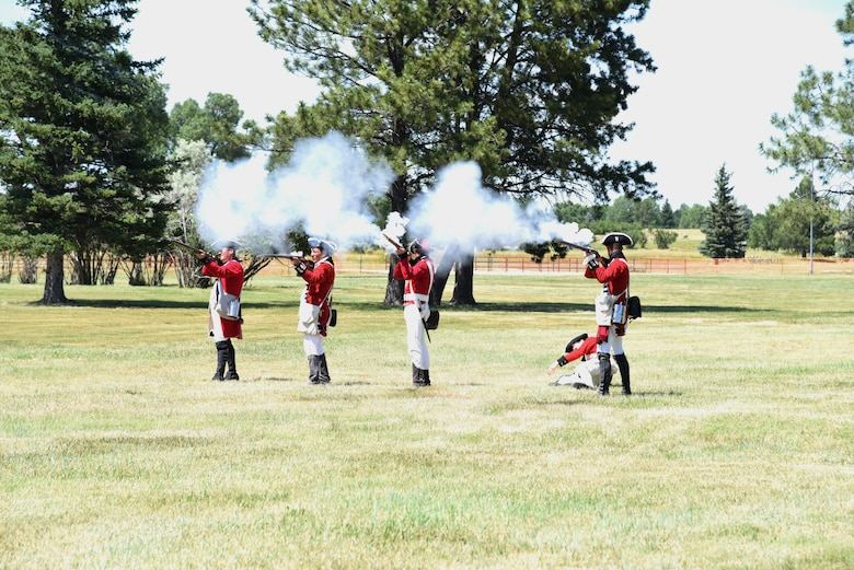 British Army Revolutionary War reenactors fire on Continental Soldiers during a demonstration at F.E. Warren Air Force Base, Wyo., July 20, 2019 as part of the annual Fort D.A. Russell Days. D. A. Russell Days allows the base to showcase the current mission while also giving visitors a realistic glimpse of the base's history. This year marks the 25th iteration of the event. (U.S. Air Force photo by Glenn S. Robertson)