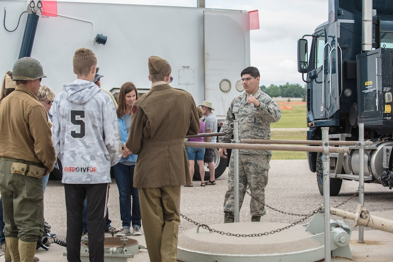 Senior Airman Cedric Delagarza, 90th Missile Maintenance Squadron missile handling team technician, shows a military vehicle to members of the local community during a tour of Uniform-01, a Minuteman III ICBM launch facility trainer at F.E. Warren Air Force Base, Wyo., July 20, 2019. These tours allow the community an opportunity to see how a launch facility operates. Fort D.A. Russell Days provides the public an opportunity to celebrate and learn about the base's rich history. (U.S. Air Force photo by Senior Airman Abbigayle Williams)