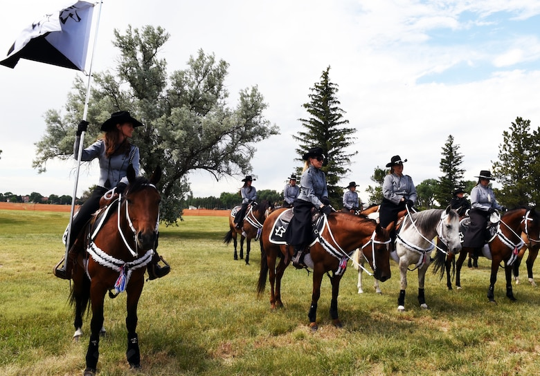 Members of the Trotters team showcase their skills during Fort D.A. Russell Days, the annual open house on F.E. Warren Air Force Base, Wyo., July 20, 2019. The Trotters perform each year during Fort D.A. Russell Days. The open house gives the community a peek into the history of the base and its role within the nation's defense. (U.S. Air Force photo by Senior Airman Breanna Carter)