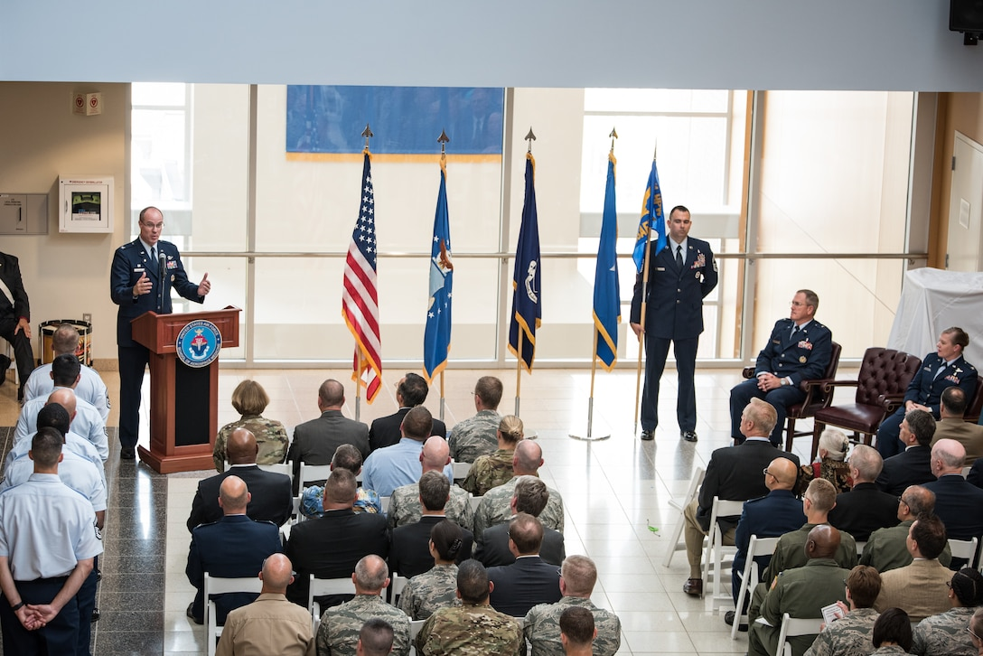 Col. (Ret.) Alden Hilton speaks to the crowd at the U.S. Air Force School of Aerospace Medicine Change of Command ceremony July 19 in the atrium of the schoolhouse. (U.S. Air Force photo/Richard Eldridge)