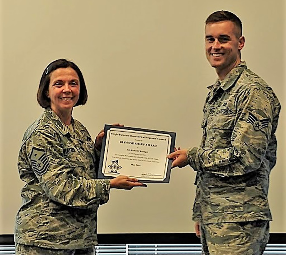 Master Sgt. Angela Hayden, 14th Intelligence Squadron first sergeant, presents the May 2019 Diamond Sharp Award to Senior Airman Clevenger, 14th Intelligence Squadron, during the July 2019 unit training assembly. The award is for exemplary performance, adherence to the Air Force Core Values, attitude, appearance and ability.