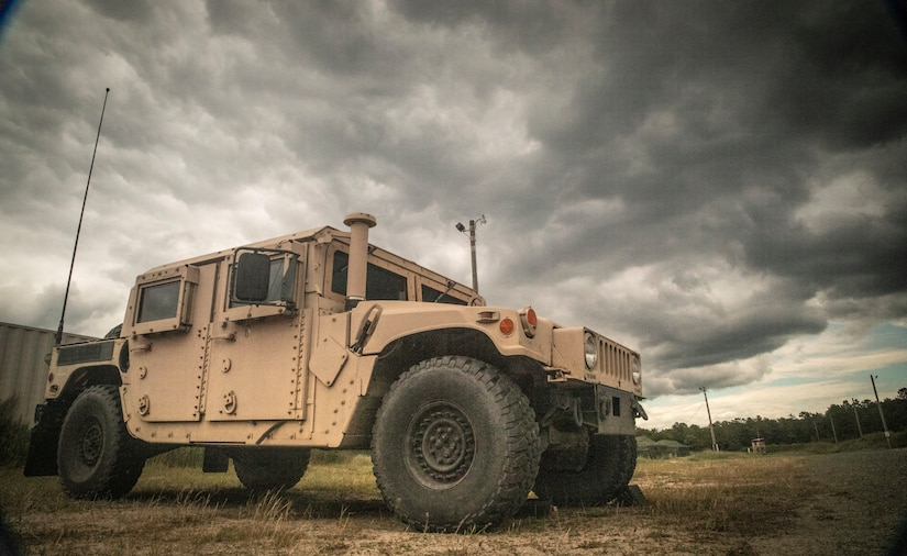 A U.S. Army HMMWV (High Mobility Multipurpose Wheeled Vehicle) parked under stormy skies during CSTX 78-19-02 at Fort Dix, NJ, June 14, 2019.