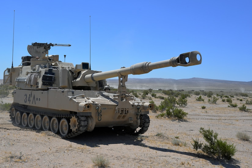A North Carolina National Guard 30th Armored Brigade Combat Team M109A6 Paladin moves into position on the gun line at the National Training Center (NTC), Fort Irwin, California, July 4, 2019.