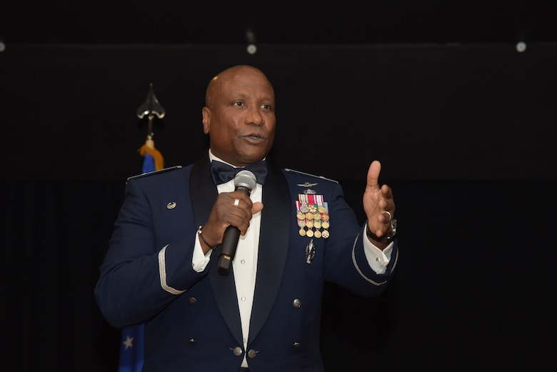 U.S. Air Force Col. Devin Pepper, 460th Space Wing commander, speaks to Airmen during the Senior Non-commissioned Officers Induction Ceremony at Heritage Eagle Bend Golf Club in Aurora, Colo., July 19, 2019. The ceremony formally honored NCOs who were selected to move into the top enlisted tier of the Air Force as master sergeants