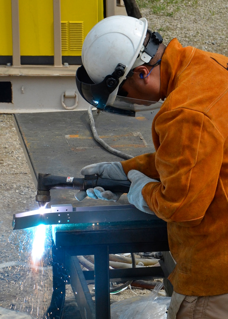 Kristian Fugrad, a property receipt supervisor at DLA's disposal site in Sagami, Japan, operates a plasma torch while demilitarizing property turned in during OCORT '19 in Michigan.