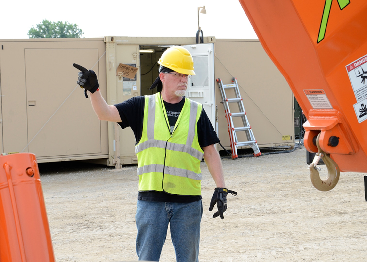 Material Examiner and Identifier Edward Jones directs materiel handling equipment during a property offload evolution at OCORT '19 in Michigan.