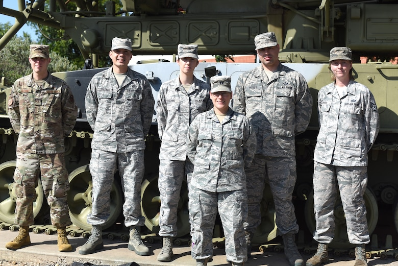 The instructors for the new 1N8 Targeting Course stand outside Di Tommaso Hall for a photo on Goodfellow Air Force Base, Texas, July 17, 2019. These instructors helped rewrite the old course to better prepare Airmen for the new career field. (U.S. Air Force photo by Senior Airman Seraiah Wolf/Released)