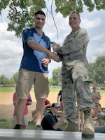 Senior Airman Vincent Kerkes, 934th Aircraft Maintenance Squadron integrated flight control systems specialist, was presented the Lt. Gen. Leo Marquez Award by Col. Anthony Polashek, 934th Airlift Wing commander, during a maintenance picnic on Minneapolis-St. Paul Air Reserve Station, Minn., July 14, 2019.