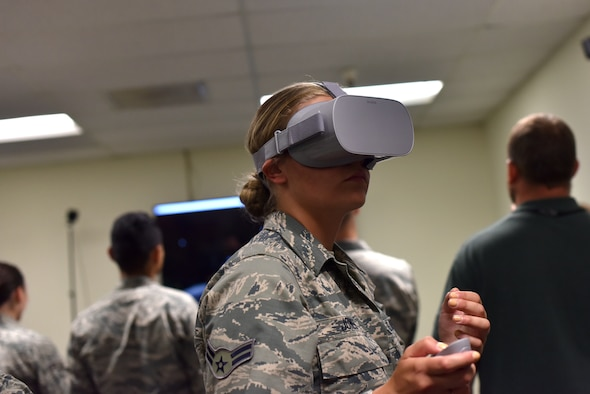 U.S. Air Force Airman 1st Class Teara Jones, a 315th Training Squadron student, uses a virtual reality system to identify aircraft as they fly past her in the new program designed for the Targeting Course in Brandenburg Hall on Goodfellow Air Force Base, Texas, July 11, 2019. The students were able to try different programs during this portion of their training, each with a different goal to help students with their career field. (U.S. Air Force photo by Senior Airman Seraiah Wolf/Released)