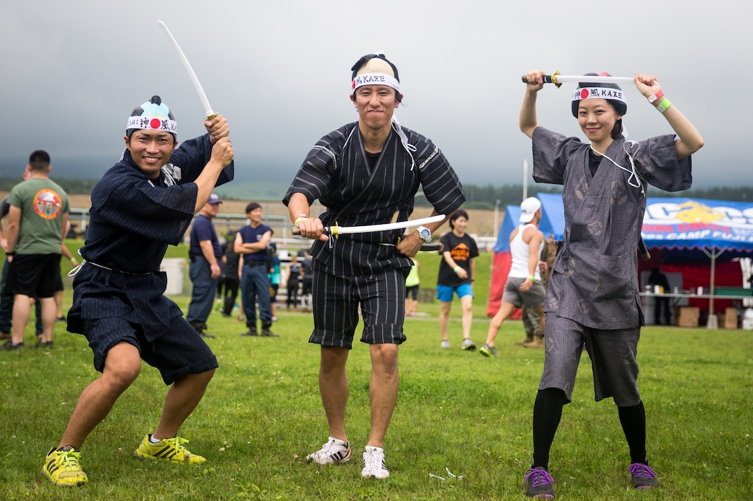 Members of the local community pose for a group photo before Combined Arms Training Center Camp Fuji's inaugural Samurai Run July 21, 2019. The Marine Corps Community Services event was held as a chance for locals and service members to strengthen relationships through friendly competition.