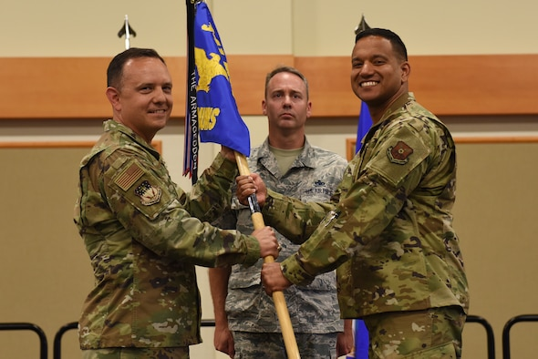 Maj. Marvin Hinkson, right, accepts command of the 341st Munitions Squadron from Col. Nathan Mitchell, 341st Maintenance Group commander, during an assumption of command ceremony July 22, 2019, at the Grizzly Bend on Malmstrom Air Force Base , Mont.