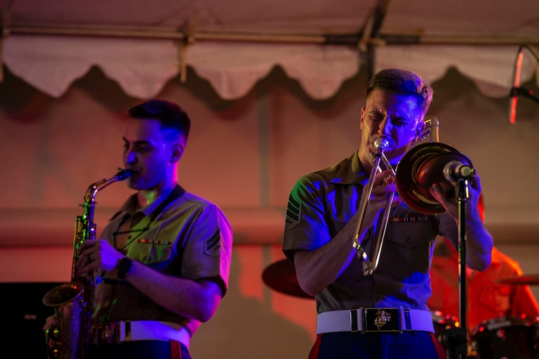 Two Marines playing instruments.