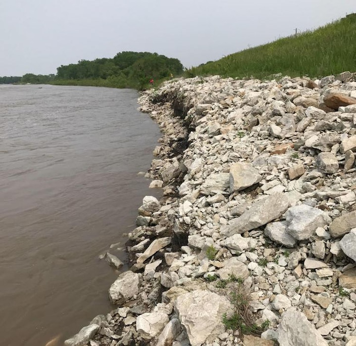 Damage to Columbus-Loup River levee, showing a loss of riprap at the toe of the levee and erosion of the embankment. Photo taken during the initial damage assessment  May 31, 2019.