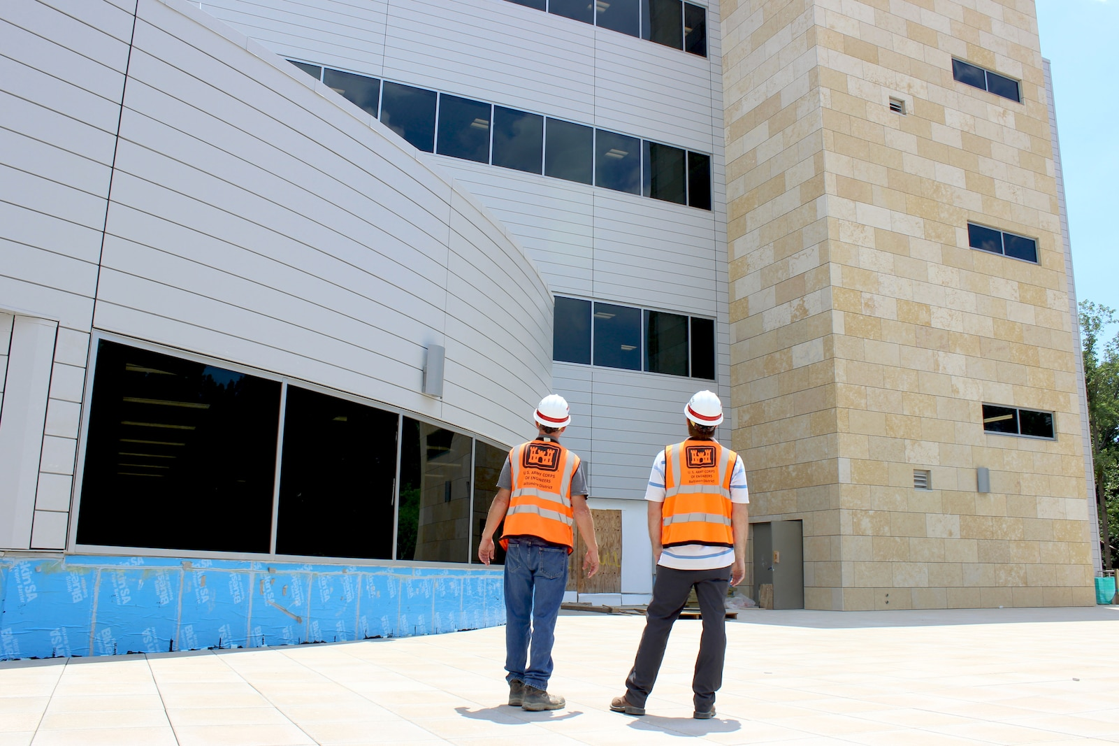 Baltimore District Construction Representatives, Robbie Powers and Martin Dougherty, stand within SAOF's courtyard on Fort Belvoir, Va. July 1, 2019. The U.S. Army Corps of Engineers, Baltimore District, is putting the finishing touches on a state-of-the-art 381,000-square-foot SAOF that will provide the U.S. Army Intelligence and Security Command a consolidated administrative facility to well-equip them for future operations.